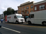 Here, two delivey trucks legally park in the center turning lane.